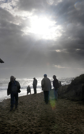 Newbury: The sun peaking out of the clouds shone on visitors to Plum Island Center to check on damage from Hurricane Sandy on Tuesday morning. Bryan Eaton/Staff Photo