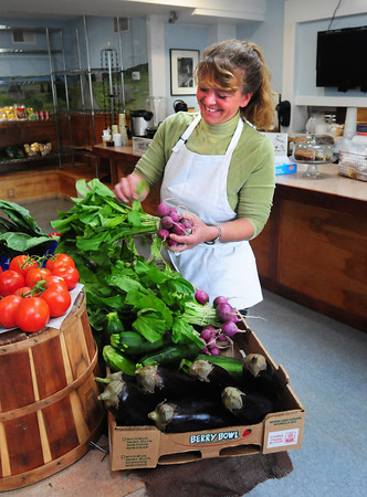 Newburyport: Stephanie Migliozzi tries to get as much local and organic produce as possible at her Food For Thought Marketplace on Plum Island which also offers prepared soup and sandwiches. Bryan Eaton/Staff Photo