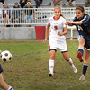 Amesbury: Hamilton-Wenham's Suzanne Rose kicks the ball away from Amesbury's Madison MacLean. Bryan Eaton/Staff Photo