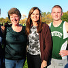 West Newbury: Maura Hickey Moore, second from left, and Kerry Coffin Carifio ran against each other in cross country 30 years ago, Moore for Triton and Carifio of Pentucket. Now their children run on the same opposing team as captains, Maureen Moore, left, and Cooper Carifio. Bryan Eaton/Staff Photo