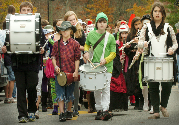 Newbury: The Newbury Elementary School band led the way for the school's annual Halloween Parade on Wednesday. Scores of parents wielding their cameras like the route around the school. Bryan Eaton/Staff Photo