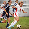 Amesbury: Amesbury's Hannah Zannini moves the ball into Hamiltion-Wenham territory with Suzanne Rose moving in behind. Bryan Eaton/Staff Photo