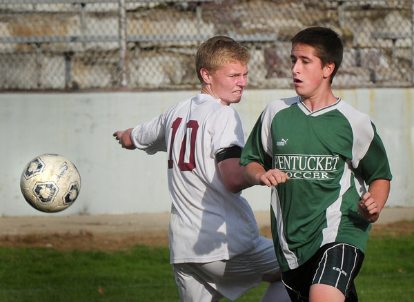 Newburyport: Pentucket's Connor Beaton gets the ball past Newburyport's Jordan Steelman. Bryan Eaton/Staff Photo