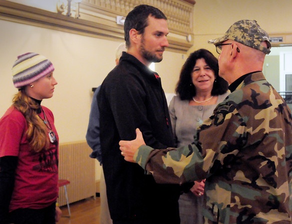 Newburyport: Kristen Creech, left, and William Mosbach meet with Newburyport Mayor Donna Holaday and Dick George, adjutant of the 101st Airborne Division Association, New England Area Chapter. The two are walking up the east coast collecting money for veteran's families. Bryan Eaton/Staff Photo