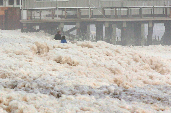Salisbury: Two youngsters ventured out into the sea foam churned up at Salisbury Beach Center on Tuesday morning. Bryan Eaton/Staff Photo