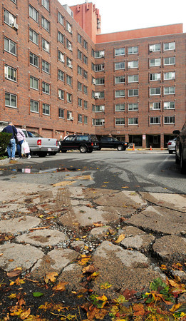 Newburyport: The sidewalk outside the Sullivan Building which houses elderly and residents with disabilities is in need of replacement say some residents. Bryan Eaton/Staff Photo