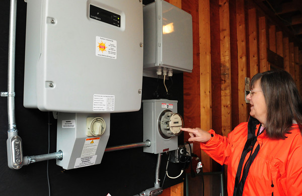 Salisbury: The unit that converts dc current collected from solar cells on the Whitley's garage into alternating current, and when the photo was taken the cells were collected more energy than being used at the time turning the electric meter backward. Bryan Eaton/Staff Photo