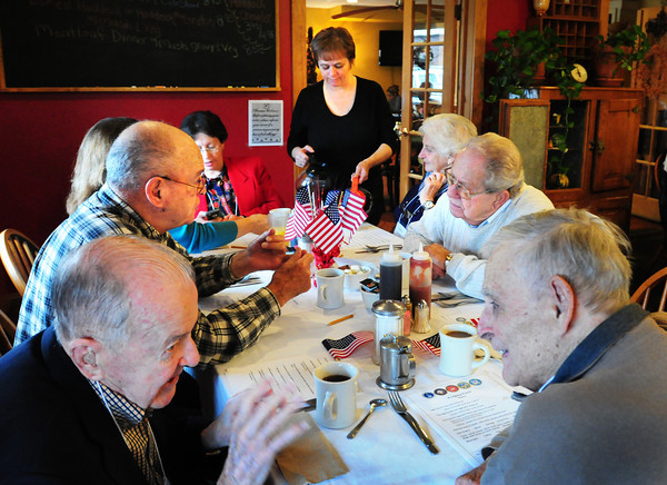 Amesbury: Sandy LeBlanc pours coffee at the Hollow Cafe as World War II veterans and family members talk at their monthly gathering. Bryan Eaton/Staff Photo