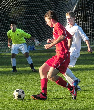 Newburyport: Masco's Luke Schell moves the ball into Newburyport territory as Clipper's Ryan Furlong moves in and goalie Shudee Wu has his eye on the ball. Bryan Eaton/Staff Photo