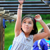 Amesbury: Sadie Rome, 6, moves along the monkey bars at the Amesbury Elementary School on Wednesday afternoon. The children in the Amesbury Recreation Department's afterschool program went outside as the temperatures finally warmed up from the morning freezing temperatures. Bryan Eaton/Staff Photo