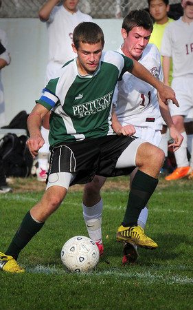 Newburyport: Pentucket's Zack Chapman and Newburyport's Thomas Graham battle for the ball. Bryan Eaton/Staff Photo