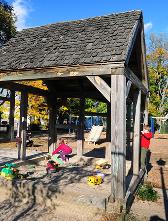 Newburyport: The roof over the sandbox at Perkins Playground is starting to show its age as children play their yesterday afternoon. Bryan Eaton/Staff Photo
