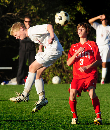 Newburyport: Newburyport's Jordan Steelman tries to head the ball away from Masconomet's Max Craig. Bryan Eaton/Staff Photo