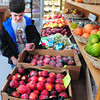 Newburyport: Casey Wanatick, 10, of Newburyport picks out a plum Food For Thought Marketplace on Plum Island. Bryan Eaton/Staff Photo