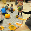 Newbury: Children learn about pumpkins which was raised in the preschool's garden with teacher Roberta Pedra. Bryan Eaton/Staff Photo