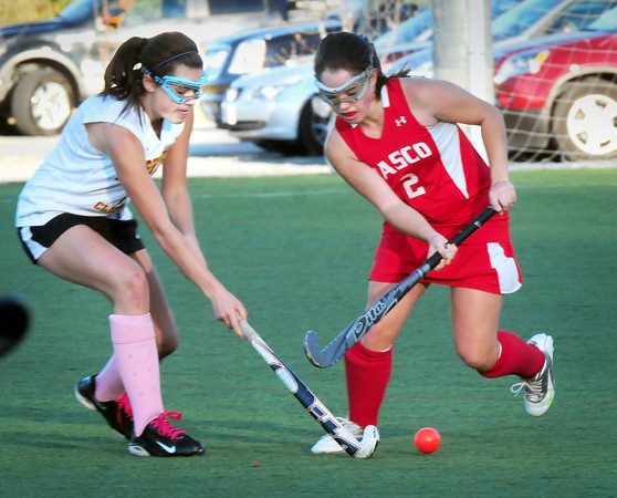 Amesbury: Newburyport's Paige Hefferan meets Masconomet's Maddie Doyle as she heads for the goal. Bryan Eaton/Staff Photo