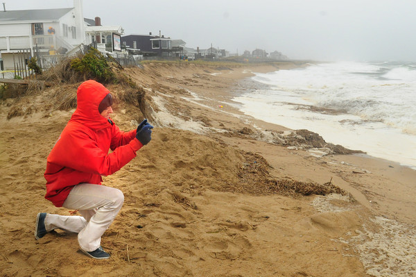 Newbury: A couple dozen people were at Plum Island Center for Monday morning's high tide. Police were blocking traffic at Water Street and Ocean Avenue allowing only residents and news media to the barrier island for a time. Bryan Eaton/Staff Photo