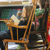 Amesbury: Bella Dannible, 8, left and Lydia Swartzentruber, 9, relax in rocking chairs while reading on Wednesday morning. They were in the library at the Amesbury Elementary School where they chose books to take home and had a little extra time to read before going back to class. Bryan Eaton/Staff Photo
