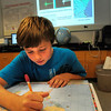 Amesbury: With a map of affected areas of Tuesday's earthquake Logan Burrill, 11, checks the distance of the quake center between Boston and Montreal in Gale Regis' Amesbury Middle School Science class. Bryan Eaton/Staff Photo