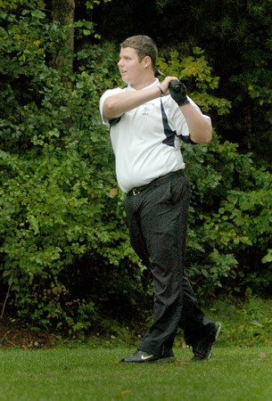 Rowley: Triton golfer Ryan Perrilli watches his drive in action against Newburyport. Bryan Eaton/Staff Photo