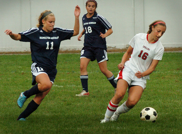 Amesbury: Hamilton-Wenham's Emily Gaucher moves in on Amesbury's Emily Martin. Bryan Eaton/Staff Photo