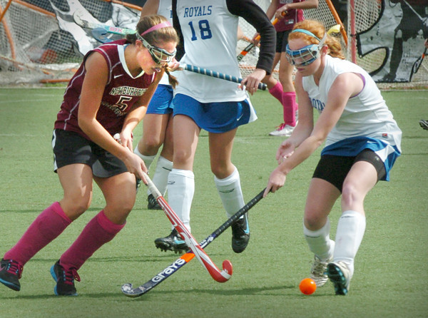 Amesbury: Newburyport's Meghan  Stanton, left, tries to get past Georgetown defender Emily Mueskes. Bryan Eaton/Staff Photo
