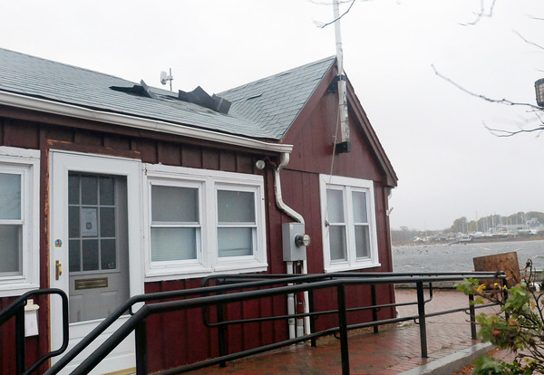 Newburyport: Shingles were lifting off the Harbormaster's Shed on Newburyport's waterfront as the wind picked  up Monday afternoon. Bryan Eaton/Staff Photo