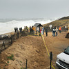 Newbury: Spectators and various media were on hand at Plum Island Center at Monday morning's high tide. The waves at the time didn't swell over the dunes. Bryan Eaton/Staff Photo