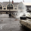 Newburyport: Waves crash over the boardwalk on Newburyport's waterfront during Hurricane Sandy. Bryan Eaton/Staff Photo