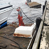 Newburyport: A boat yard crew removes part of the dock the was damaged late Monday night as the wind and waves beat the Prince of Whales against them. Bryan Eaton/Staff Photo