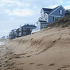 Newbury: Some of the sand that was scraped up on Plum Island beach looking south of the center was eroded, but protected the homes there. Bryan Eaton/Staff Photo