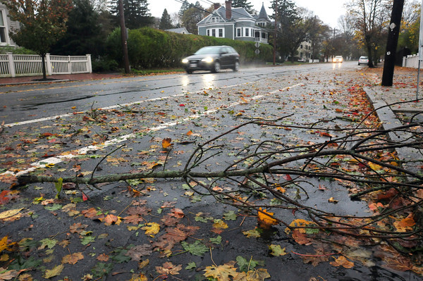 Newburyport: Tree limbs and leaves littered the area, here on High Street in Newburyport. Many leaves that had already fallen may have helped in stopping more limbs from falling since there's less resistance. Bryan Eaton/Staff Photo