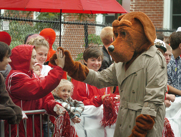 Amesbury: McGruff the Crime Dog worked the crowd of youngsters as the Fireball Run cars came into the downtown. Bryan Eaton/Staff Photo