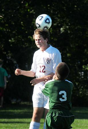 Newburyport: Newburyport's Henry Jacqz uses his head to get the ball from North Reading. Bryan Eaton/Staff Photo