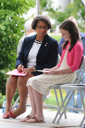 """Newburyport: Former Newburyport Exchange Club president Kathleen Baily talks with Isabella Lesinski,11, before the start of the 3rd annual Field of Honor Dedication on the Bartlet Mall in Newburyport Sunday. Both spoke at the event Baily giving teh Keynote and Lesinski reading her poem """" The Twin Towers"""". JIm Vaiknoras/staff photo"""