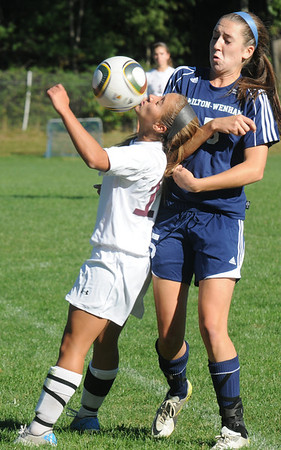 Newburyport:Newburyport's Alex Peffer uses her chin to control the ball against Hamilton Wenham's Samantha Charette during their game at Cherry Hill Wednesday. JIm Vaiknoras/staff photo