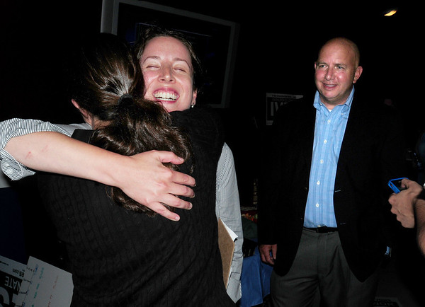 Salisbury: Kathleen O'Connor Ives gets a hug from a well-wisher as state representative Michael Costello looks on as she won the democratic nod in the 1st Essex Senate race. Bryan Eaton/Staff Photo