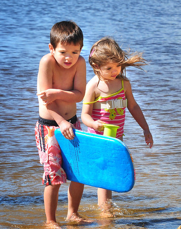 Amesbury: Elliot Perry, 4, is a little chilly from a breeze as he and his sister, Elise, 2, of Amesbury come out of the water at Lake Gardner Beach in Amesbury on Tuesday afternoon. The weather is expected to warm up for the weekend. Bryan Eaton/Staff Photo