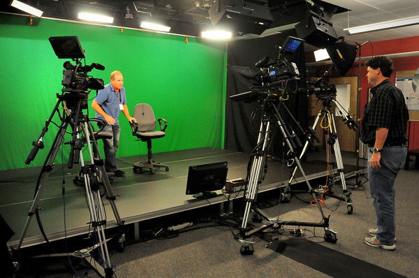Amesbury: Russ Munroe, left, executive director of Amesbury Community Television with public access coordinator Tony Noon in their overhauled studio at Amesbury High School. Bryan Eaton/Staff Photo
