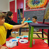 Newburyport: Some old, bland chairs are getting a colorful facelift at the Kelley School Teen Center. Painting them on Tuesday afternoon are, from left, Michelle Gendron, 10, Olivia Giunta, 13, and Ryan Thibault. Bryan Eaton/Staff Photo