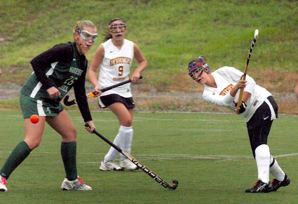 Amesbury: Newburyport's Kate McCauley knocks the ball into Manchester-Essex territory at Amesbury Sports Park. Bryan Eaton/Staff Photo