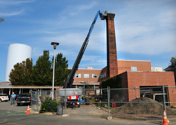 Newburyport: A smokestack that stood above the Anna Jaques Hospital began to be dismantled yesterday morning. The structue, believed to be built in the 1930's, was used as exhaust for the old power plant. Bryan Eaton/Staff Photo