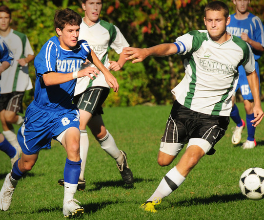 West Newbury:Georgetown's John Laut, left, and Pentucket's Davis Miller move for the ball at Pipestave Hill field. Bryan Eaton/Staff Photo