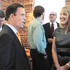 Newburyport: State Treasurer Steven Grossman, left, talks with Nancy Angell, owner with her husband David Pierre, of Orange Leaf frozen yogurt shop after a tour. Grossman spoke at the Greater Newburyport Chamber of Commerce and Industry Breakfast and later helped in the grand opening ribbon cutting of the yogurt shop. Bryan Eaton/Staff Photo