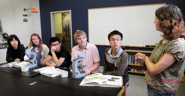 Amesbury: Ten students from China are attending the Sparhawk School in Amesbury for four years, instead the one year that exchange students usually spend visiting another country. Three of them are pictured in Shannon Gmyrek's biology class with local students, from left, Quincy Zheng, Rachel Perry, Haoran He, Matt Shalp and Gabriel Wu. Bryan Eaton/Staff Photo