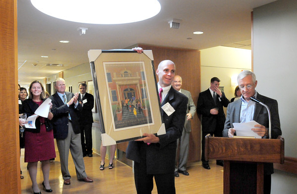 Newburyport: Institution for Saving President and CEO Michael Jones shows off a print of the original front entrance to the Anna Jaques Hospital by artist Lance Hidy, presented by Capital Campaign Chairman Charlie Cullen, right. The print was a thank you to the bank which led the campaign with $1.5 million for the new 18-bed unit single occupancy rooms which was unveiled last night. Bryan Eaton/Staff Photo