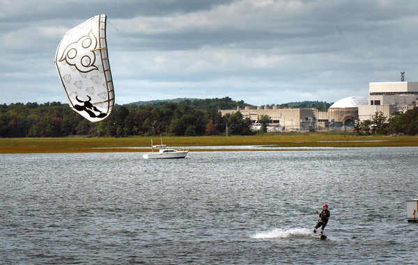 Seabrook: A kite boarder zig zags in Seabrook Harbor yesterday afternooon under cloudy skies. The weather for the weekend is mostly sunny with a chance of showers. Bryan Eaton/Staff Photo