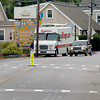 Newburyport: Extra signage, including flashing lights, warn motorists of pedestrians coming in and out of Mersen USA on Merrimac Street in Newburyport. There is now more traffic on the thoroughfare since the Hines Bridge opened last month. Bryan Eaton/Staff Photo