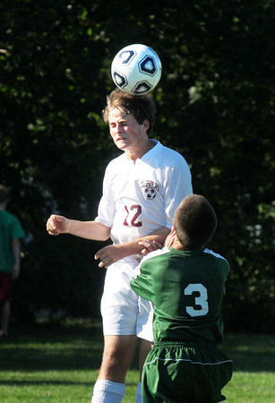 Newburyport: Newburyport's Henry Jacqz uses his head to get the ball from North Reading. Bryan Eaton/Staff Photo