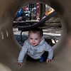 Newburyport: James Manning, 14 months, crawls through the tunnel at the playground at the Inn Street Playground in Newburyport. He was crawling towards his grandmother Agnes Manning of Newburyport who was watching him for the day. Bryan Eaton/Staff Photo
